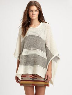 This poncho is perfect.  Pendleton, The Portland Collection - Banded Knit Poncho - Saks.com.... So comfy!