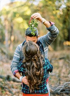 15 Reasons Why Winter Engagement Photos Are The Best - Mistletoe isn't just for indoor shoots. Use this holiday greenery as a cheeky photo prop in any location to spice up your shots.     Photo by  Ryan Ray .