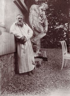 Circa 1900: French sculptor Francois Auguste Rene Rodin (1840 - 1917) in the garden of his villa at Meudon, near Paris. Behind him is the original plaster statue of 'The Creation of Man'. (Photo by Edward Gooch/Edward Gooch/Getty Images)