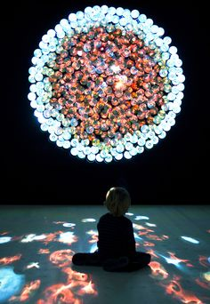 "Spanish artist Daniel Canogar took footage from 360 used DVDs and projected the images back onto their surfaces in a sculptural installation titled Sikka. The projected film segments were all selected based on their color, sound, shape and movement, creating an amazing ""audio-visual mosaic."""