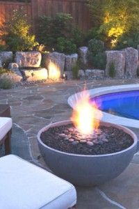 "Hemisphere 36-- high performance concrete firepit by the pool. Made by Solus Decor out of Vancouver, BC. 36"" w, 16.5"" h. Gas or propane burner."