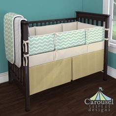 Crib bedding in Solid Gold Satin, Natural Organic, Mint and Gold Chevron, White Pimatex, Solid Antique White. Created using the Nursery Designer® by Carousel Designs where you mix and match from hundreds of fabrics to create your own unique baby bedding. #carouseldesigns