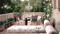 A walled patio or balcony morphs into a luxe haven, with trellised climbing roses, trim planters, and carefully chosen accessories. Pastel chaises covered in outdoor fabrics make a lavish place to lounge with a morning coffee and the paper. Joani Stewart-Georgi of Montana Ave. Interiors in Los Angeles designed the space to boast a garden look,