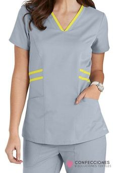 Striping detail at the waist and collar bring an upscale touch to this Grey's Anatomy Marquis top. Healthcare Uniforms, Medical Uniforms, Hospital Uniforms, Scrubs Outfit, Scrubs Uniform, Salon Wear, Landau Scrubs, Greys Anatomy Scrubs, Medical Scrubs