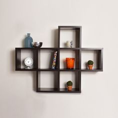 This laminated wall shelving unit by Cubby brings warmth and style to any room. Seven storage cubbies provide ample shevling space for your books or CD's, while the walnut finish and design adds an eye-catching visual detail to the decor of any room.