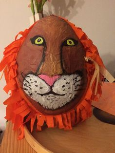Lion piñata. This guy died a violent death and his sweet innards were devoured by a pack of wolf pups.