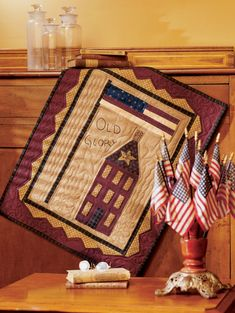Old Glory: The grand old flag stands tall within a primitive sawtooth border on this folk art wall hanging.