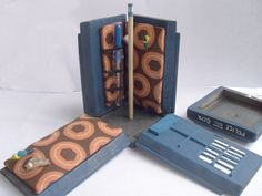 TARDIS travel sewing kit - pole serves to keep the lid on and hold a spool of thread!
