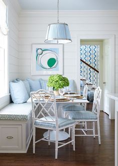 Beautiful white and blue kitchen breakfast nook. I can see this design and color scheme being in a beach side cottage, or just in a home that has a beach theme to it.