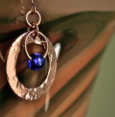 Fairy Circle copper hand forged earrings with cobalt blue glass bead