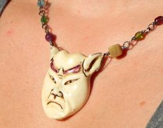 Japanese Noh Mask Assemblage Necklace by AllEyeC on Etsy, $75.00