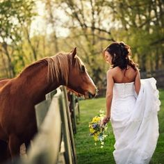 Definately! //A beautiful bridal session with a rustic backdrop completed with a horse, cowboy boots and a stunning bride.