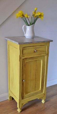 Could one build something like this from a cabinet & drawer from ReStore and a reclaimed wood top? Hmm. English Yellow by Annie Sloan with Clear and Dark Wax to bring out the details.
