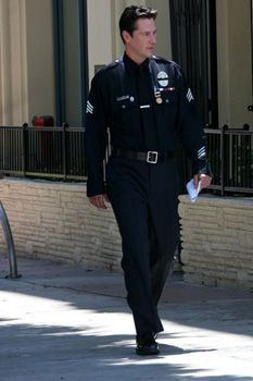Keanu Reeves in uniform - if this pulled me over, I would not be sad.