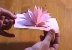 Is a gigantic box of Godiva chocolates and a dozen roses not in the budget this Valentine's Day? Then how about making this very easy, one-piece-of-paper pop-up flower card for your sweetie? Pop Up Flower Cards, Pop Up Cards, Paper Flower Ball, Paper Flowers, Paper Cards, Diy Cards, Paper Lotus, Origami And Kirigami, 3d Rose