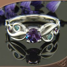 Organic Mounting with Alexandrite center stone and colored diamond accents.