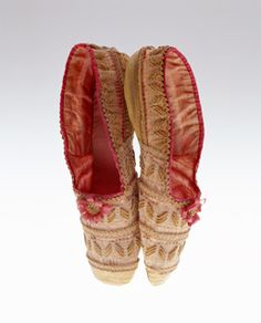 Shoes    1830s-France    Material:       The uppers covered in connected braids of straw and horsehair; deep-pink silk ribbon trimming and cockade; lined pink silk taffeta; squarish toes; leather sole.