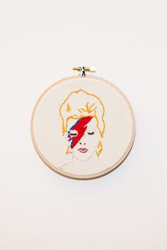"Koe-Zee-David Bowie emboridered wall hanging. Framed in 5.5"" wooden embroidery hoop. HANDMADE IN SEATTLE, WA PIPE AND ROW"