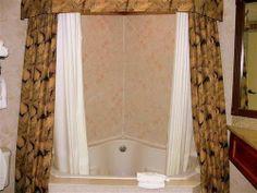 Curtain Ideas: Shower curtain to make bathroom look bigger
