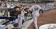 San Francisco Giants' Buster Posey is greeted at the dugout after scoring on a double by Pablo Sandoval against the San Diego Padres in the first inning of a baseball game in San Diego, Saturday, July 13, 2013. (AP Photo/Lenny Ignelzi)