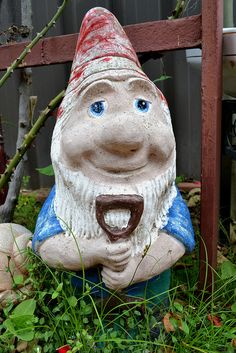 "Every Container garden needs ""Garden Gnome"" how could you just not have one?  Keep you eye out at Garage and yards sales for ones with character just like this one."