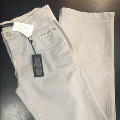 """White & Black beige/grayish denim (NOIR) Exclusive premium NOIR jean for women with a straighter figure.  Sits lower on the waist, without being too low.  Modern silhouette in premium , stretch denim, with a contemporary wash.  Designed to comfortably skim the body & flatter a woman who has less of a defined waist,  minimal curve through her hips snd seat, and a slimmer thigh.  Created to """"Make Women Feel Beautiful"""". Noir/White & Black Jeans"""