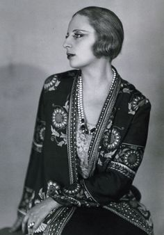 """Art Deco, a classical, symmetrical, rectilinear style that reached its high point between 1925-1935, drew its inspiration from such serious art movements as Cubism, Futurism, and the influence of the Bauhaus. Of all the artists pursuing the style """"Arts Decoratifs"""", one of the most memorable was Tamara De Lempicka. May 16, 1898, Warsaw, Poland.--March 18, 1980 Cuernavaca, Mexico."""