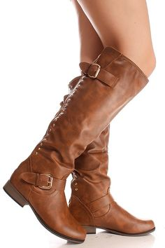 These tan knee high boots are fun and stylish,faux leather,buckle and zipper closure going down back of calf, metal studs going down both sides of zipper on calf,side buckle design.