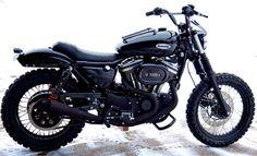Harley Davidson Sporster Scrambler using  Burly Brand shocks and handlebars.