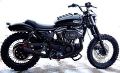 Harley Davidson Sporster Scrambler using  Burly Brand shocks and handlebars.