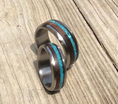 This gorgeous wedding band set consists of two of our handmade titanium rings that weve inlaid with beautiful desert ironwood and an offset narrower