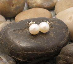 White button pearl stud earrings £17.00