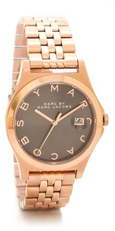 Marc by Marc Jacobs The Slim 30mm Watch, Logo letters mark the clean dial of this rose gold-tone Marc by Marc Jacobs watch. A petite date window details one side. Link band. Hinged-snap clasp.