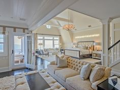 Bedroom with multiple seating areas, staircase and private balcony | Rose Hill Point - Water Mill