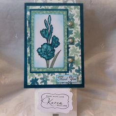 Blooms and Bliss DSP, Island Indigo and the stamp set is Gift of Love (Hostess Set) also metal rimmed pearls