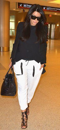 Kim Kardashian in Helmut Lang pants, Céline sunglasses, Hermès bag, and Givenchy shoes. Vogue.com