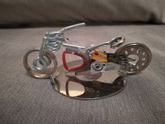 Recycled metal motorcycle Recycled Art, Recycling, Cufflinks, Metallic, Motorcycle, Accessories, Recycle Art, Recyle, Biking