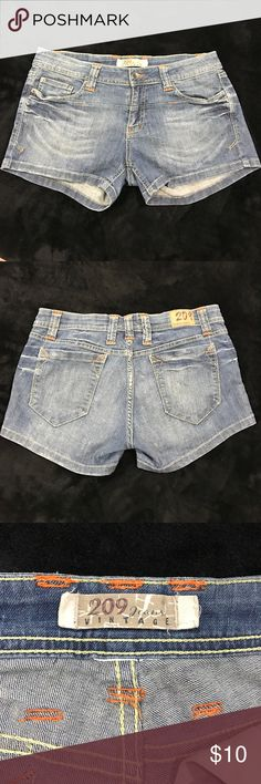 Closet Clear Out 🌸 Jean shorts ⚡️Flash sale price applied- expires in 24 hrs 📌Adorable short jean shorts. Size tag is cut off but these are a size 11 juniors. They have a distressed look and have orange thread as an accent color. Super cute on and they have a nice stretch 209 Jeans Vintage  Shorts