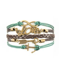 "Our popular Modestly leather wrap bracelets - this one features an infinity symbol, the word ""Love,"" an arrow with heart, and an anchor. Brown and green wit"