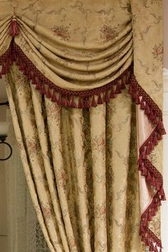Versailles classic is reimagined in this elegant curtain set with gold silky borcade fabric. You will love how gracefully the light bounces off the divinely hand tailored curvaceous swag, and how nicely the red fringes along the swags and tails, and red tassels hanging on the hand-stitched fabric buttons, complete the the overall design.   customize, designer, draperies, drapery, elegant, embroidery, fringes, gold, jabots, luxury, valance, victorian, window treatment, yellow, red,ready made,