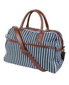 I really really want this bag!   A canvas duffle bag featuring a thin stripe pattern. Contrast faux leather trimmings. Short top handles. Removable crossbody strap. Buttoned patch pocket in the front. Three interior pockets. Burnished hardware. Fully lined. Medium in weight. DETAILS: - 12' H x 18.5' W x 6.5' D - 6.5' shoulder drop - Shell: 100% cotton; Trim: 100% PU; Lining: 100% polyester - Imported