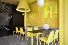 Construction union has designed an eye-catching interior for a 'hi-pop' tea restaurant in foshan, china. with nostalgia in mind, the eatery is defined by a palette of bright yellow and black tile, a choice the studio hopes will appeal to a more youthful frame of mind