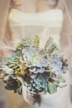 succulent + feather bouquet by  http://hollyflora.com  Photography by http://ourlaboroflove.com
