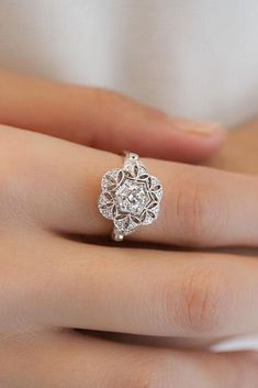 An antique style diamond engagement ring.