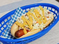 West Virginia Style Hot Dog:The toppings are the star elments of Katie Lee's fuss-free hot dog; she finishes the franks with meaty beef chili and cool coleslaw, plus a drizzle of yellow mustard.