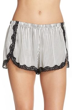 Catching up on the beauty sleep in these incredibly comfy, lace trim satin shorts.