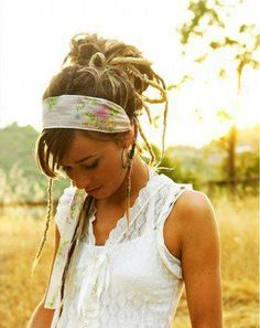 This carefree look is achieved with pinning the dreds in a loose bun high on crown of head and adding a beautiful scarf for a vintage look.