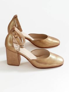 For everyday celebrating: high heel mary jane in soft gold leather. Tapered toe and delicate heel cap. Adjustable ankle strap hits high on the ankle. Covered block heel. Padded footbed. Leather lining