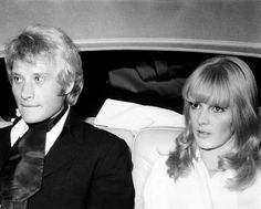 Bulgarianborn French singer Sylvie Vartan sitting in a car with her husband French singer and actor Johnny Hallyday 1968