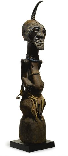 SONGYE power figure, Democratic Republic of the Congo; wood, metal, horn, beads, fibers, animal hide, snake skin; 45 1/2 by 12 by 9 in. 115.6 by 30.5 by 22.9 cm.